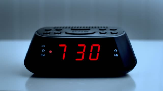 Digital alarm clock, time from 7.29 to 7.30.