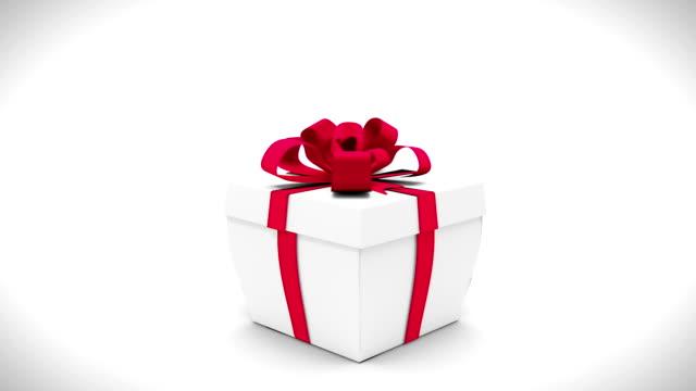 digital animation of birthday gift exploding and revealing number twenty one - 20 24 år bildbanksvideor och videomaterial från bakom kulisserna