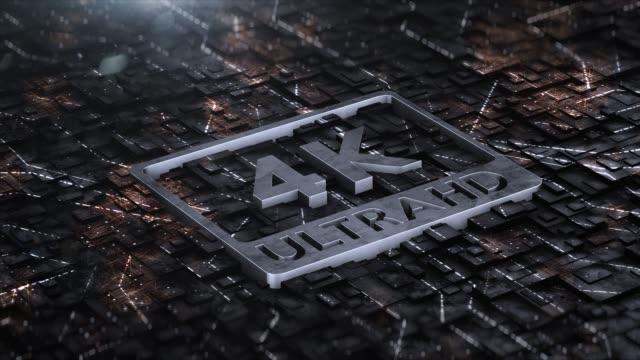 digital background with 4k ultra hd metal logo - ultra high definition television filmów i materiałów b-roll