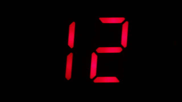 Digital clock countdown from sixteen to zero. Digital timer in red color over black background video