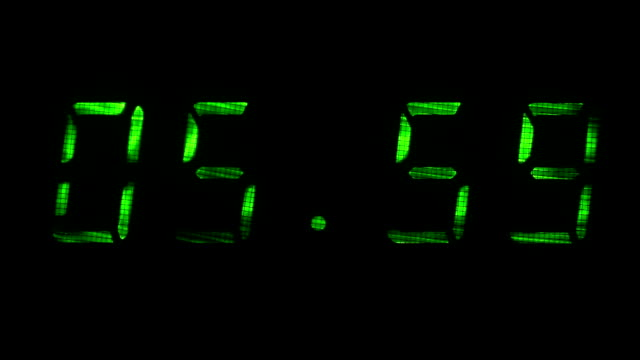 Digital clock shows time of 05 hours 59 minutes to 06 hours 00 minutes video