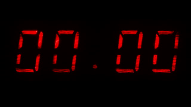Digital clock with fluorescent display shows 00:00 in red color