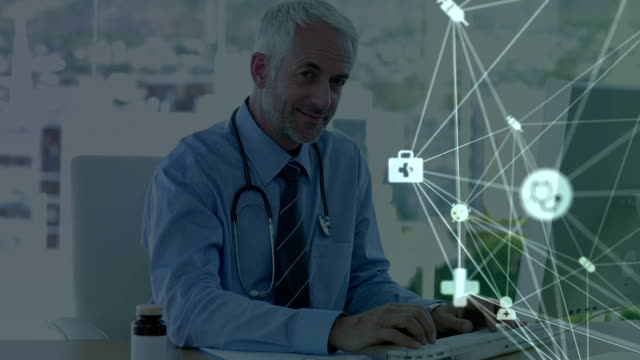 Digital composite video of web of connections with icons moving against doctor using computer