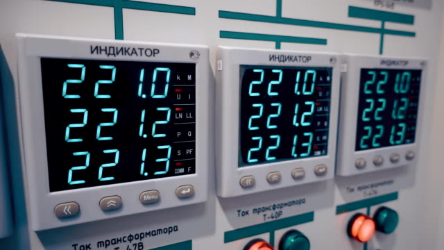 Digital display showing the exact voltage of 220 volts on industrial equipment