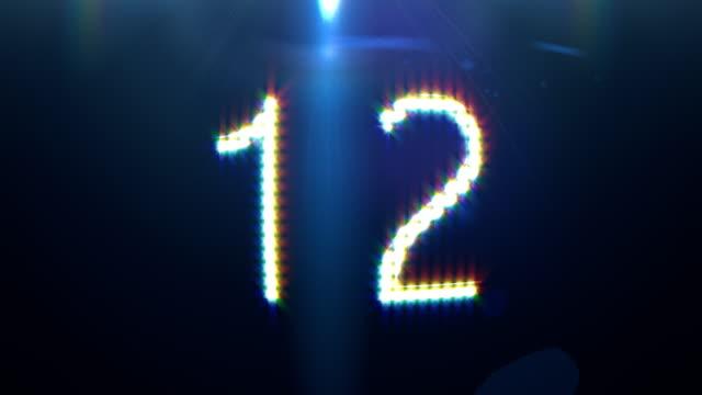 vídeos de stock e filmes b-roll de digital generated video of countdown timer - 20 24 anos