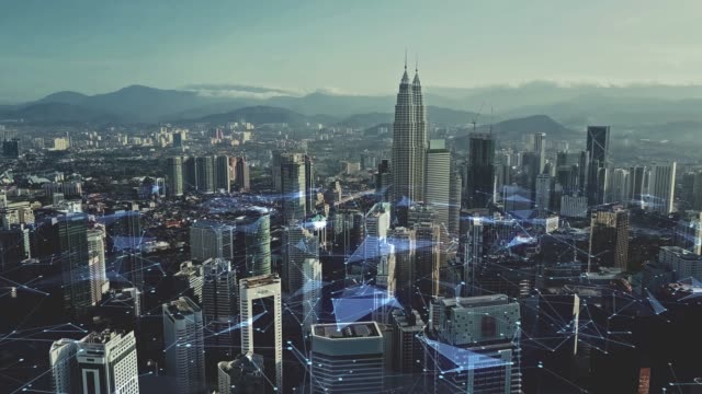 digital network connection lines of kuala lumpur. financial district and business centers in smart urban city in asia. skyscraper and high-rise buildings at night. - malese video stock e b–roll