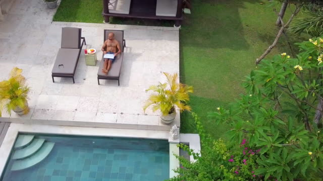 Digital Nomad at work in Villa Shot with DJI Mavic Pro sunbathing stock videos & royalty-free footage