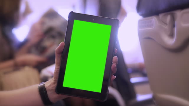 Digital tablet on a plane. Chromakey. video
