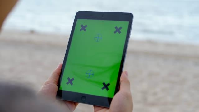 Digital tablet on the beach