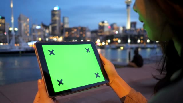 Digital tablet on the night city Auckland pier