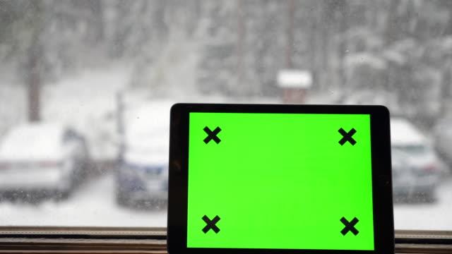 Digital Tablet on Window during snowfall