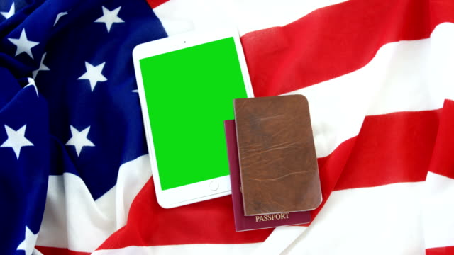 digital tablet, passport and visa on american flag - passports and visas stock videos and b-roll footage