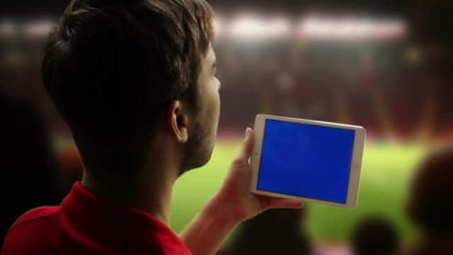 Digital tablet sports fan at the game. Chromakey screen. video