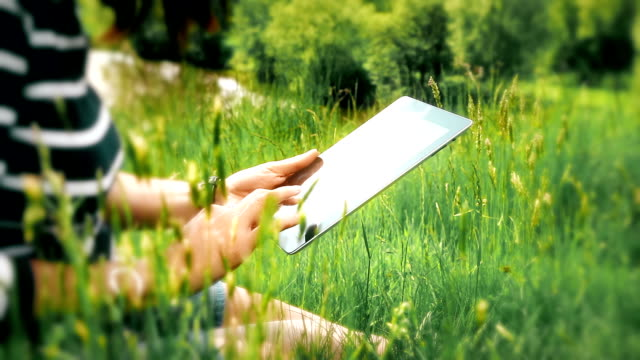 Digital tablet woman, outdoors in beautiful location. video