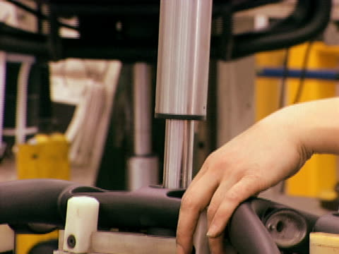 Digital Torque Applied Female 2 A medium close-up of a woman on an assembly line placing bolts, then tightening with a torque gun. bolt fastener stock videos & royalty-free footage