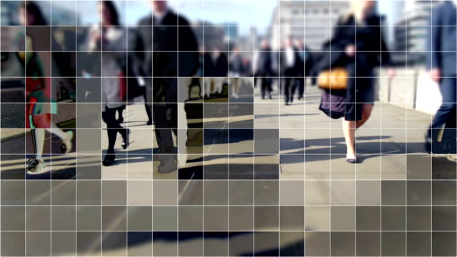 Digitized commuters on London Bridge. Commuters from the City walking home over London bridge with a cubist digital grid effect. mosaic stock videos & royalty-free footage