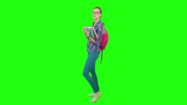 Diligent Student Blonde student girl reading book then closing it turning to the camera and smiling happily on green screen background full length stock videos & royalty-free footage