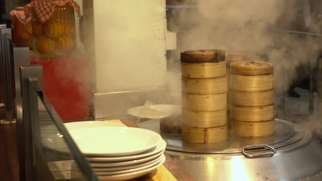 Dim sum bamboo steamers at a food stall