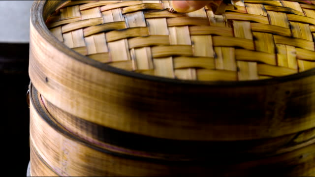 Dim Sum Cooking Pot Stickers in Bamboo Steamer. lid stock videos & royalty-free footage