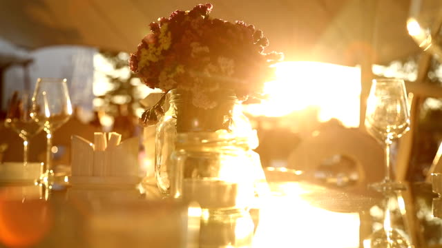 Dinner table in sunset Dinner table in sunset wedding stock videos & royalty-free footage