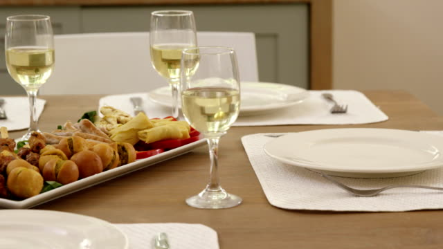 Dinner table with food at home video