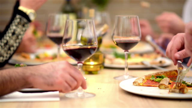 DOLLY: Dinner table with pizza in restaurant video
