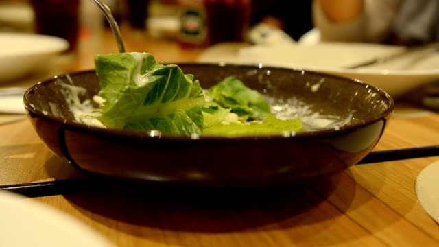 dinner time with green vegetable salad bowl video