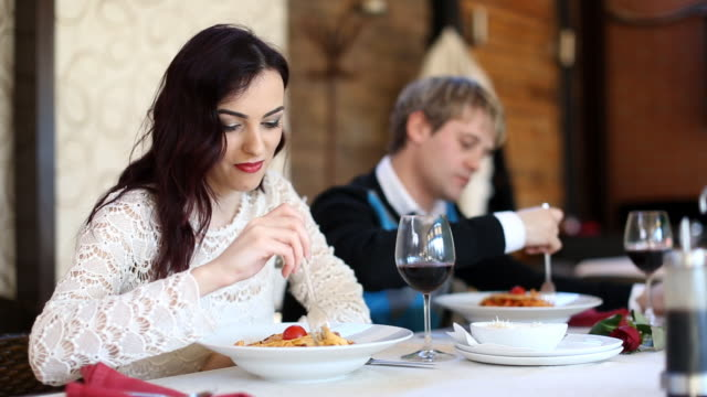 Dinner (HD) Young couple eating in the restaurant fork stock videos & royalty-free footage