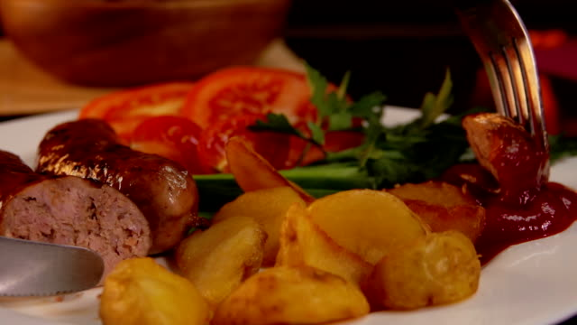 dinner with grilled sausages - ketchup video stock e b–roll