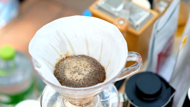 Dipping Coffee,Pour hot water in the coffee filter paper. video