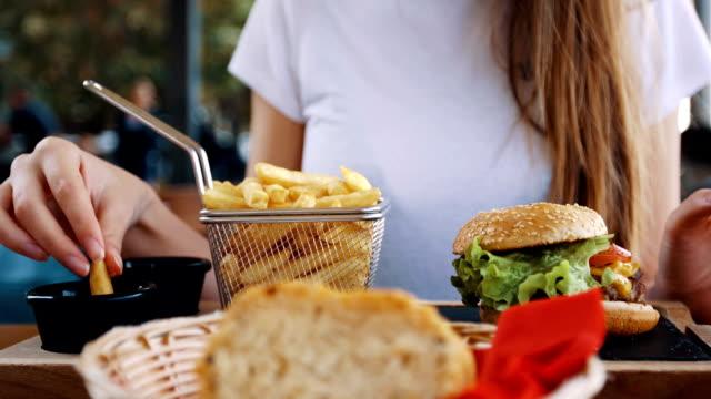 dipping french fries at ketchup - ketchup video stock e b–roll