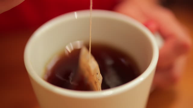 dipping tea bag - tea cup stock videos & royalty-free footage