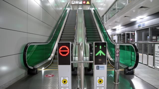Directional sign light to indicate the direction of operation of the escalator. Seoul, South Korea.