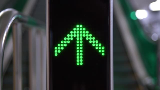 Directional sign light to indicate the direction of operation of the escalator.
