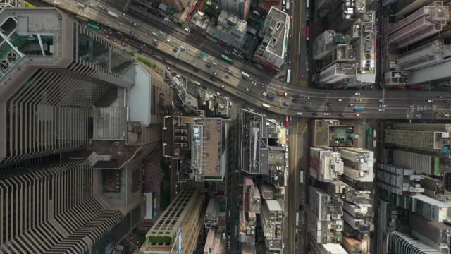 Directly above real time of the Hong Kong city 4k Real time aerial view with directly above composition of Hong Kong cityscape crowded building in day time. Modern and technology city in Asia. light effect stock videos & royalty-free footage