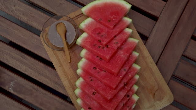 Directly Above Shot Of Watermelon Slices Directly above shot of watermelon slices and honey with cinnamon. watermelon stock videos & royalty-free footage