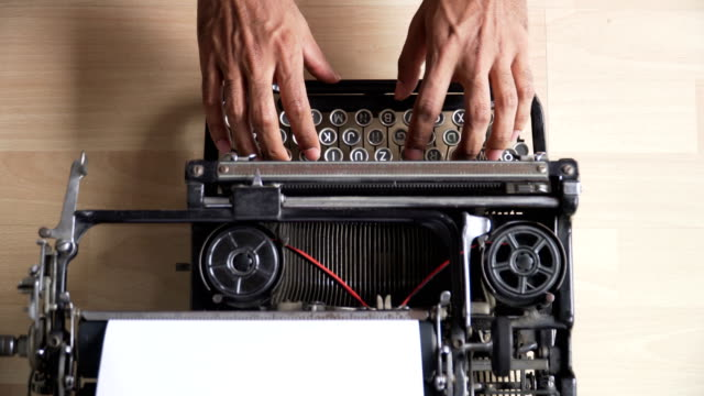 directly above view: Asian's hands use Retro typewriter that is German keyboard directly above view: Asian's hands use Retro typewriter that is German keyboard typewriter stock videos & royalty-free footage
