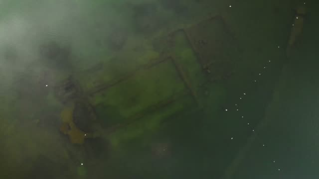 directly above view of ancient sunken basilica in iznik lake, turkey - archeologia video stock e b–roll