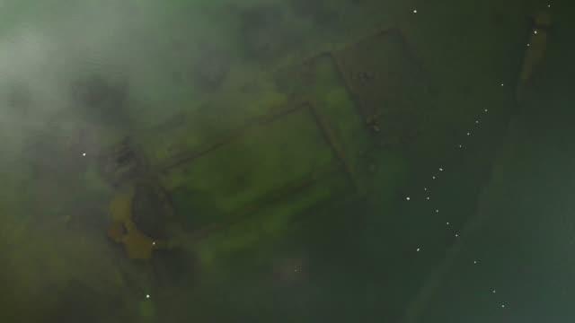 direkt ovanför beskåda av forntida sunken basilika i iznik lake, turkiet - basilika katedral bildbanksvideor och videomaterial från bakom kulisserna