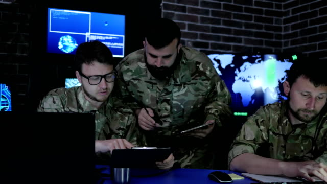 director in uniform in monitoring room on war base, people video