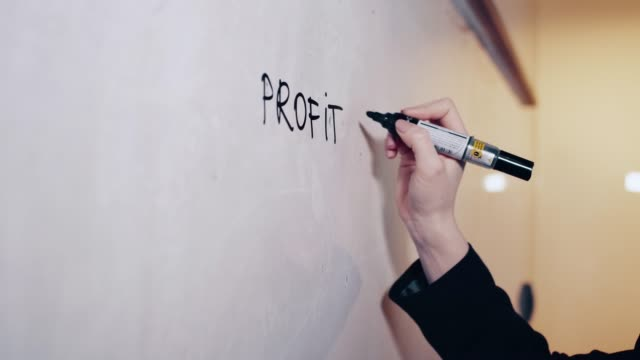 Director writing business strategy on a whiteboard video