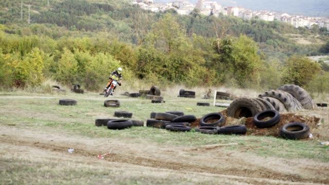 dirt biker driving on an off-road terrain. - supercross video stock e b–roll