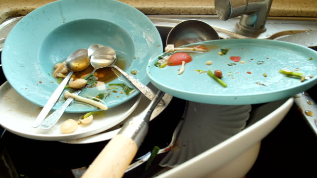 Dirty dishes in kitchen Dirty dishes in kitchen washing dishes stock videos & royalty-free footage