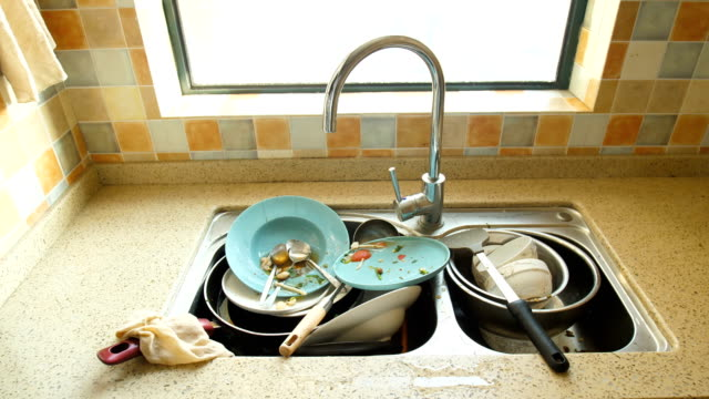Dirty dishes in kitchen Dirty dishes in kitchen kitchen sink stock videos & royalty-free footage