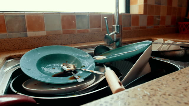 Dirty dishes in the sink Dirty dishes in the sink washing dishes stock videos & royalty-free footage