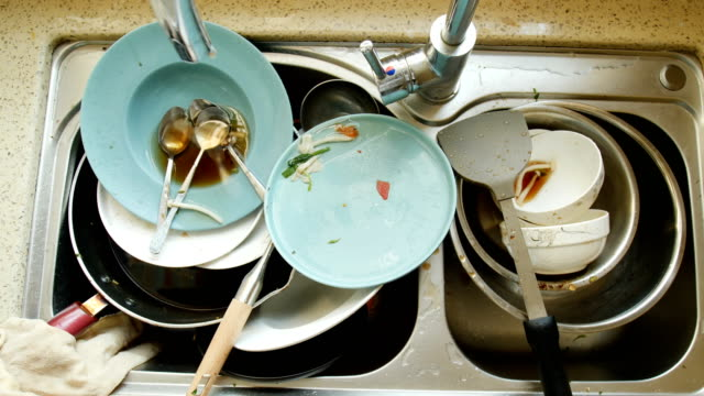 Dirty dishes in the sink Dirty dishes in the sink kitchen sink stock videos & royalty-free footage
