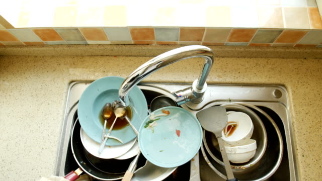 Dirty dishes Dirty dishes kitchen sink stock videos & royalty-free footage