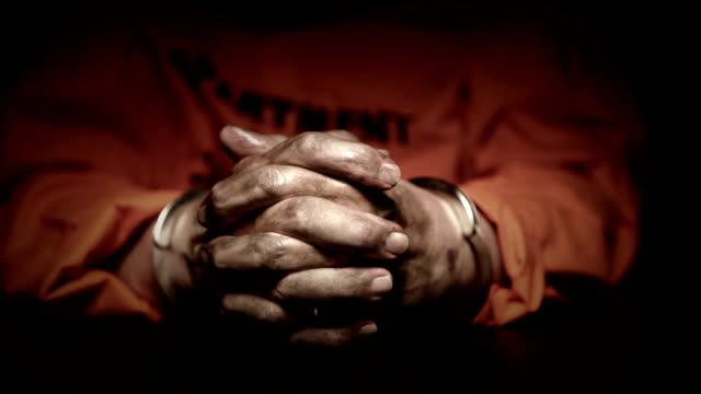 dirty hands in handcuffs - fånga bildbanksvideor och videomaterial från bakom kulisserna