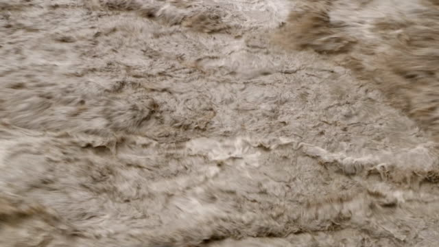 dirty river with muddy water in flooding period during heavy rains in spring - imperfection stock videos & royalty-free footage