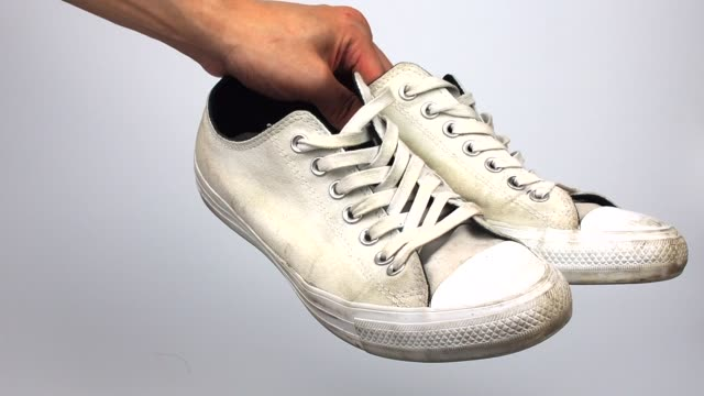 dirty white shoes with hand lifting - обувь стоковые видео и кадры b-roll